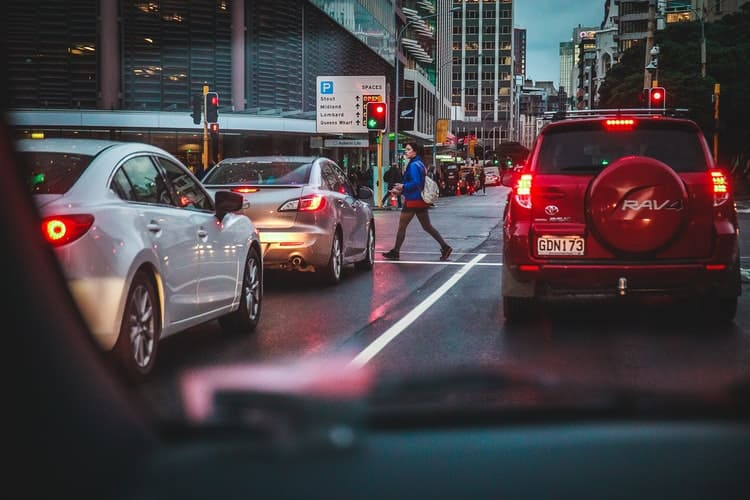 Paying attention to other drivers and pedestrians during traffic