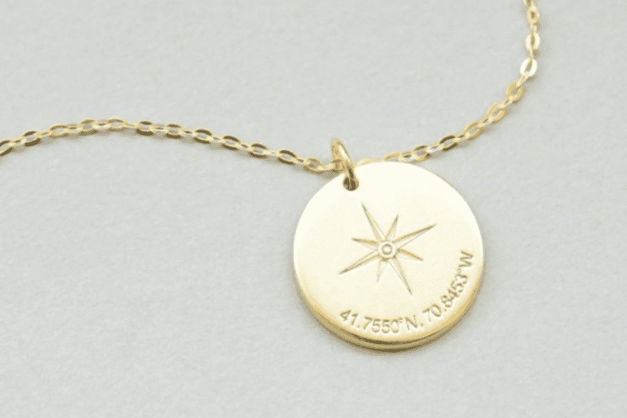 A gold personalized compass pendant necklaces are perfect gifts for the woman who wants nothing