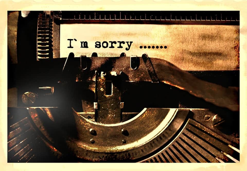 A typewriter typing a letter that says I am sorry in hopes of Making Amends