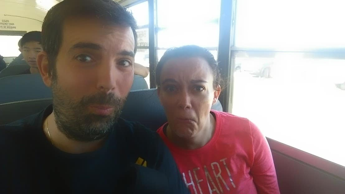 Darcee and Eric riding a bus to a Spartan Mud Run where they almost died